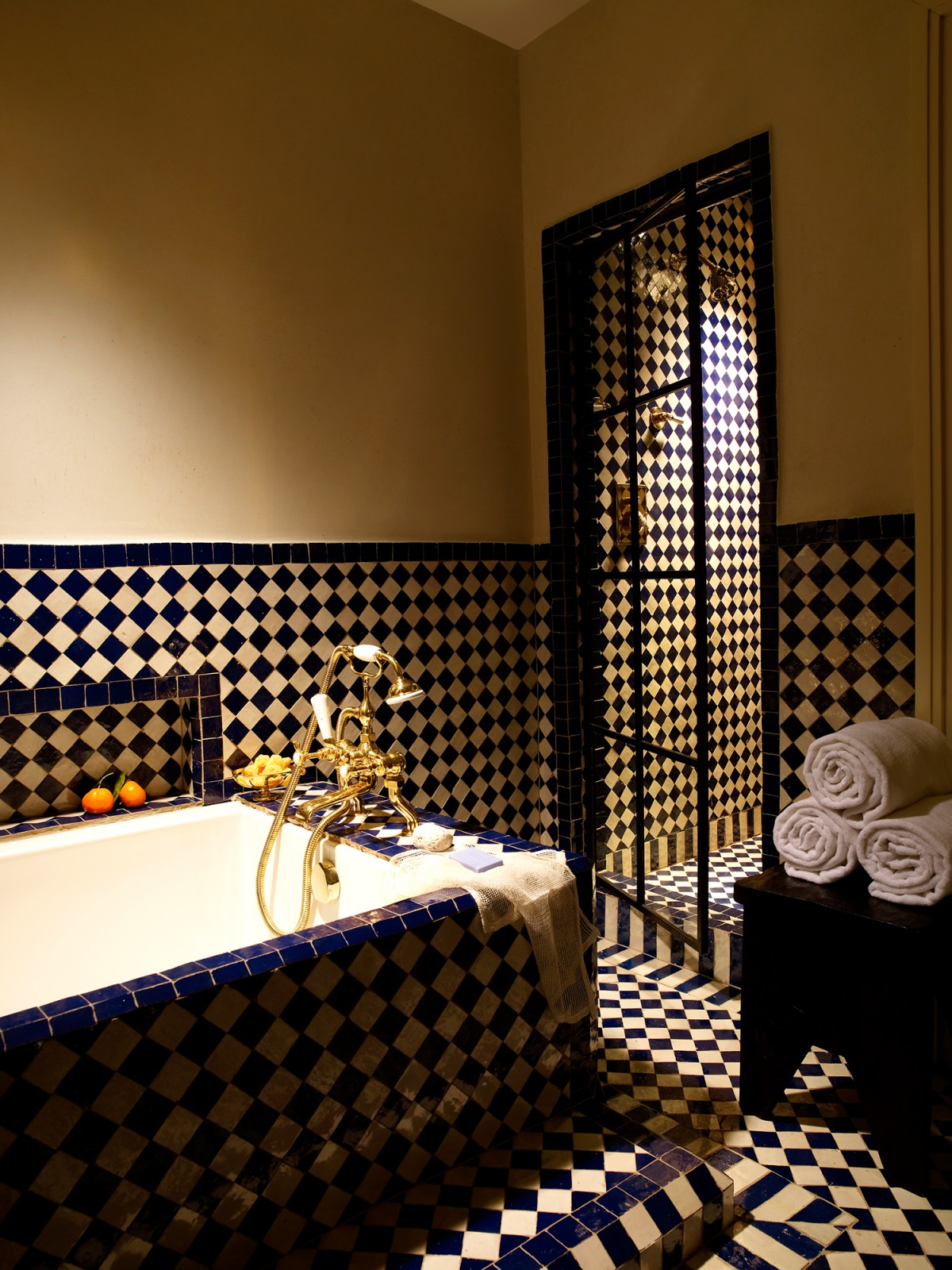 View of the tub, shower and patterned tile in the Deluxe King room