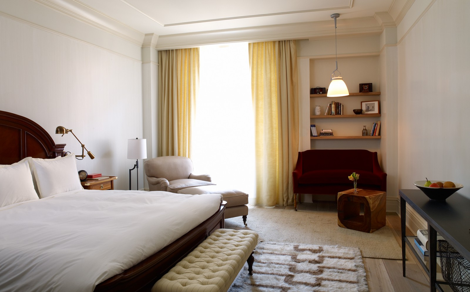 View of the bed, seating and desk in the Deluxe King Room