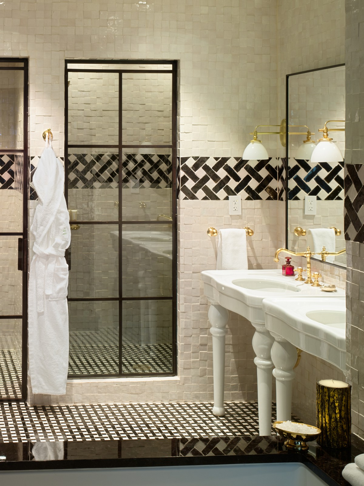 Detail of double sinks and showers in the N. Moore Penthouse at the Greenwich Hotel