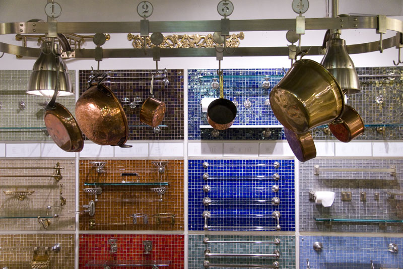 Towel bars and hanging copper pots on display at Urban Archaeology Antiques and Vintage