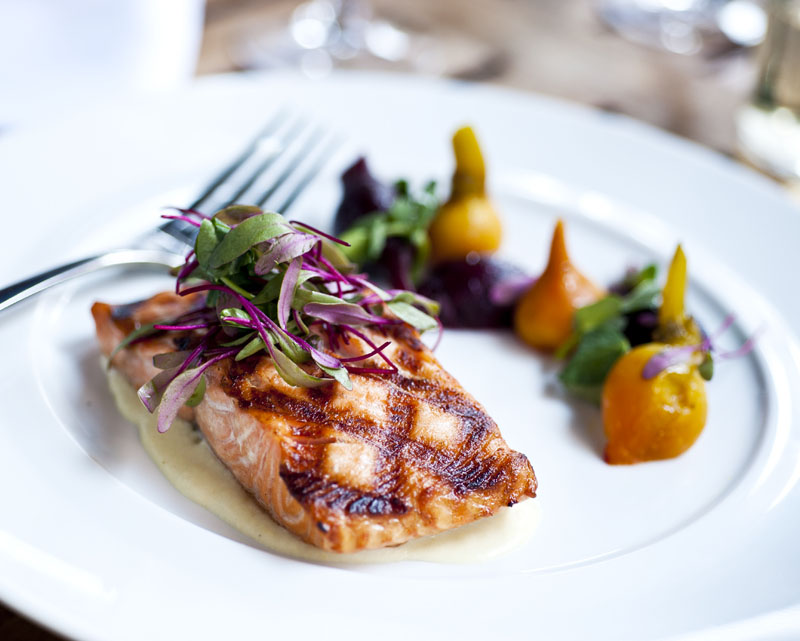 Grilled Atlantic Salmon dish at The Tribeca Grill located close to The Greenwich Hotel
