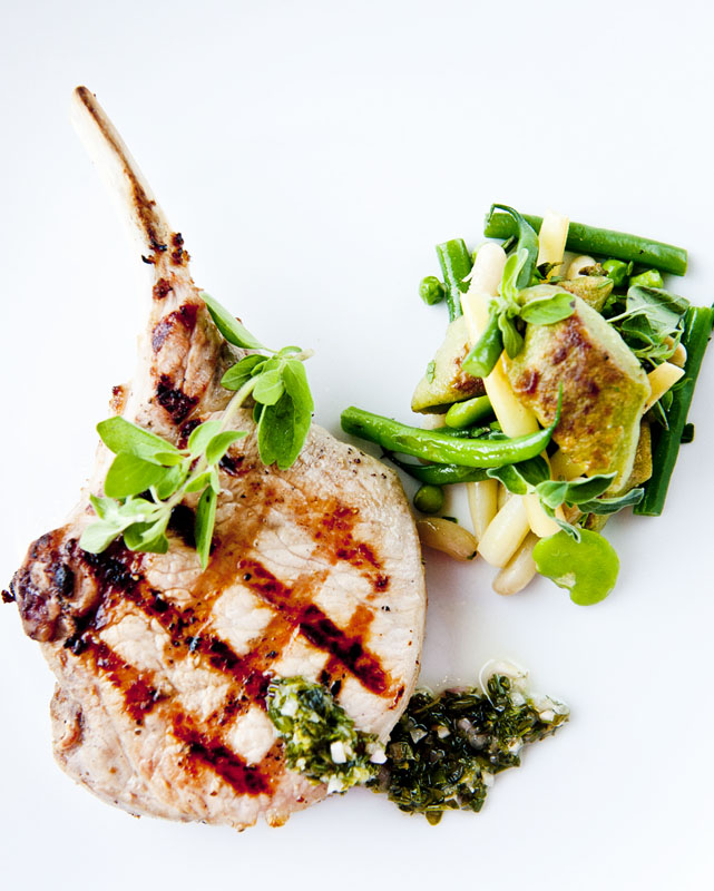 A grilled pork chop dish from The Tribeca Grill located close to The Greenwich Hotel
